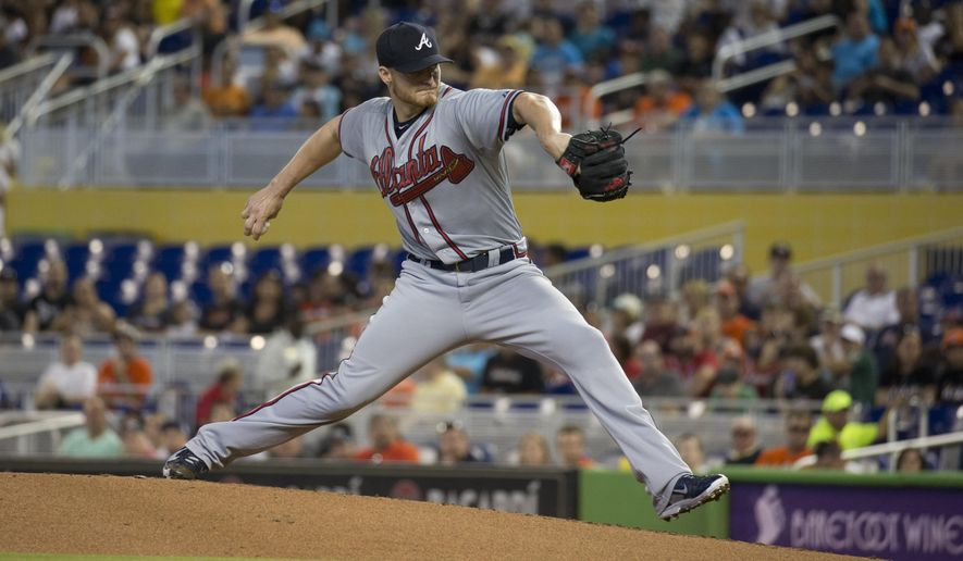 Atlanta Braves starting pitcher Shelby Miller throws to the Miami Marlins during the first inning of a baseball game in Miami, Sunday, May 17, 2015. (AP Photo/J Pat Carter)