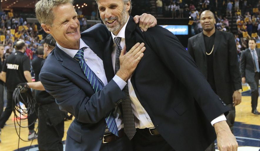 Golden State Warriors head coach Steve Kerr, left, celebrates with player development coach Bruce Fraser after beating the Memphis Grizzlies in Game 6 of a second-round NBA basketball Western Conference playoff series Friday, May 15, 2015, in Memphis, Tenn. The Warriors won 108-95 to win the series 4-2. (AP Photo/Mark Humphrey)