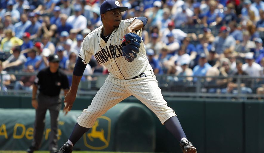 Wearing the uniform of the former Negro League's Kansas City Monarchs, Kansas City Royals pitcher Edinson Volquez throws in the first inning of a baseball game against the New York Yankees in Kansas City, Mo., Sunday, May 17, 2015. (AP Photo/Colin E. Braley)