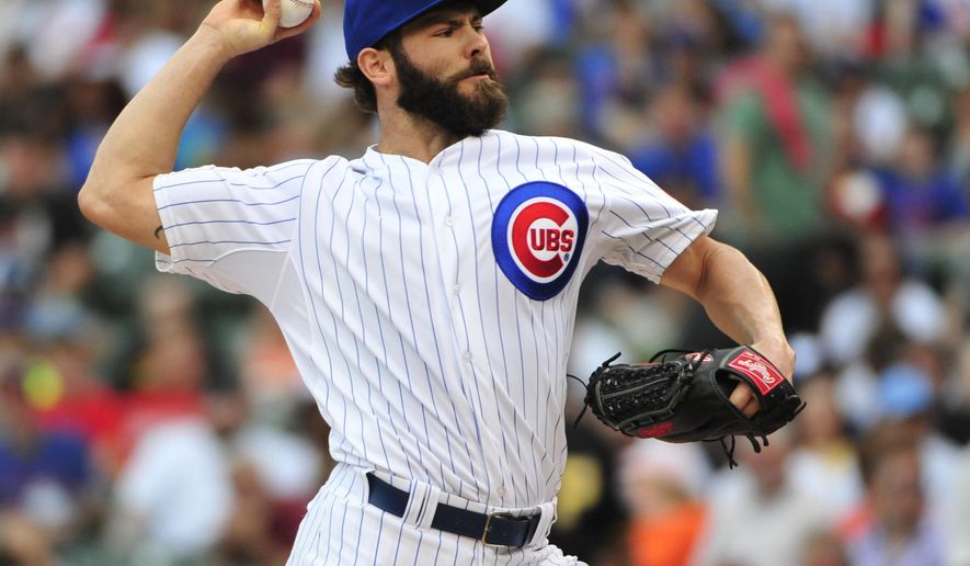 Chicago Cubs starting pitcher Jake Arrieta throws against the Pittsburgh Pirates during the first inning of a baseball game, Sunday, May 17, 2015 in Chicago. (AP Photo/David Banks)