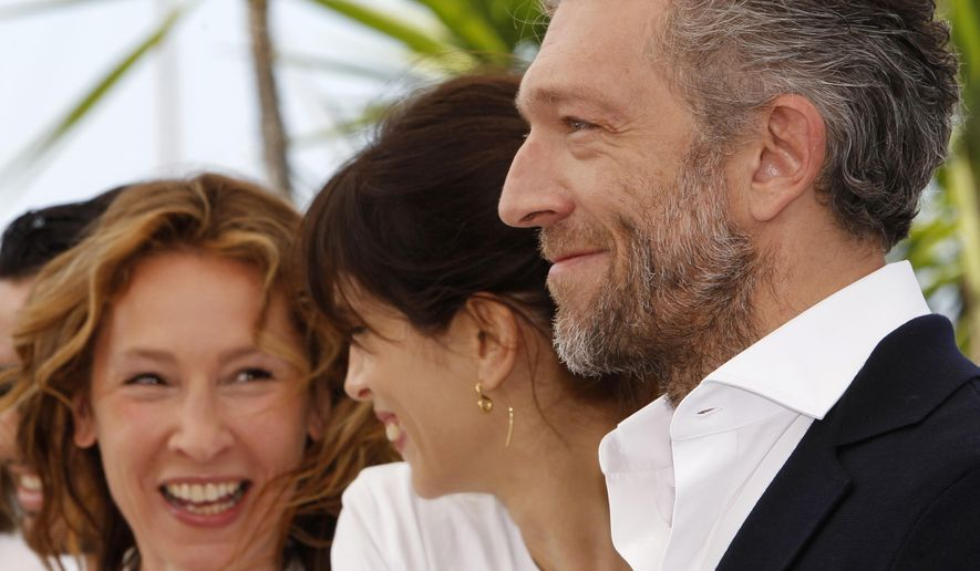 From right, actor Vincent Cassel, director Maiwenn, and actress Emmanuelle Bercot during a photo call for the film Mon Roi (My King), at the 68th international film festival, Cannes, southern France, Sunday, May 17, 2015. (AP Photo/Lionel Cironneau)