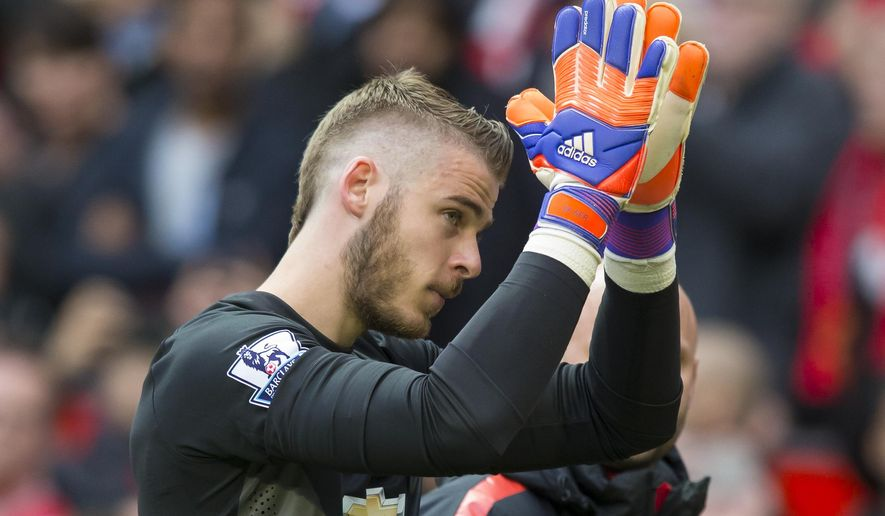 Manchester United's goalkeeper David De Gea applauds supporters as he makes his way from the pitch as he is substituted during the English Premier League soccer match between Manchester United and Arsenal at Old Trafford Stadium, Manchester, England, Sunday, May 17, 2015. (AP Photo/Jon Super)