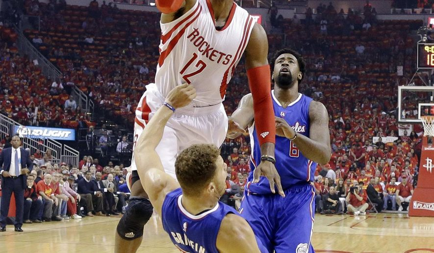 Houston Rockets center Dwight Howard (12) shoots over Los Angeles Clippers forward Blake Griffin (32) during the first half in Game 7 of the NBA basketball Western Conference semifinals Sunday, May 17, 2015, in Houston. (AP Photo/David J. Phillip)