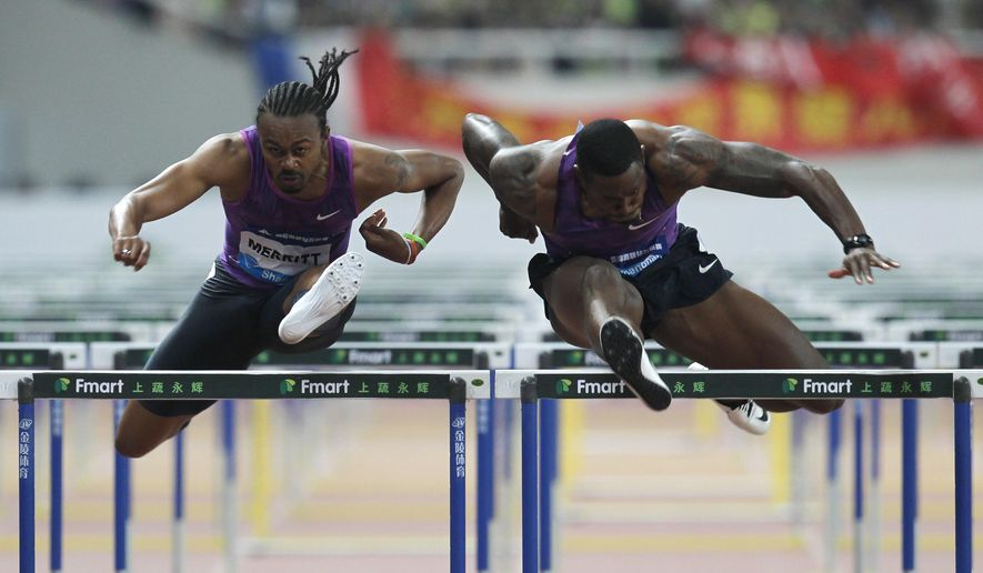 Aries Merritt of the U.S, left, competes against fellow American David Oliver, right, in the final of the men's 110-meter hurdles during the IAAF Diamond League Track and Field meet in Shanghai, China, Sunday, May 17, 2015. (AP Photo)