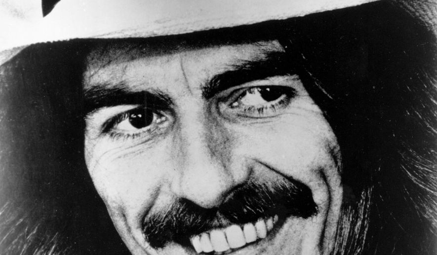 FILE  - Former Beatle George Harrison smiles in this 1974 file photo at an unknown location. A guitar Harrison played at a time when Beatlemania was taking flight has sold for nearly half a million dollars at a New York auction. Julien's Auctions said the 1963 Mastersound electric guitar went for $490,000 Friday, May 15, to an undisclosed bidder. Julien's said Harrison borrowed it from a British music store and played it on stage several times in England and in Channel Islands in the summer of 1963. (AP Photo/File)