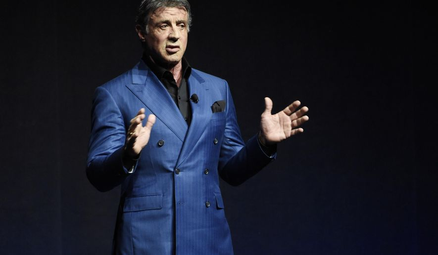 """FILE- In this April 21, 2015 file photo, Sylvester Stallone introduces a clip from the film """"Creed"""" at the Warner Bros presentation during CinemaCon 2015, at Caesars Palace, in Las Vegas. Sylvester Stallone, the artiste, eschews Cannes this year for his exhibit at the Museum of Modern and Contemporary Art in Nice. (Photo by Chris Pizzello/Invision/AP, File)"""