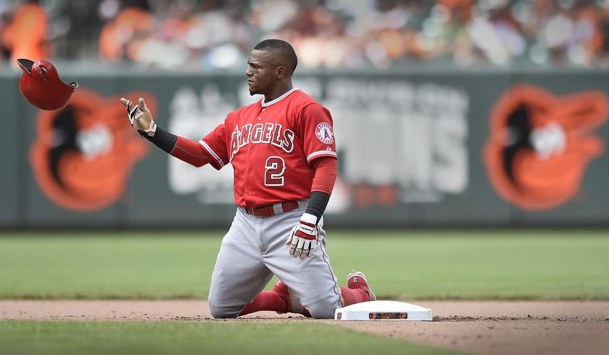 Los Angeles Angels' Erick Aybar tosses his batting helmet after being tagged out at second on a double play against the Baltimore Orioles in the seventh inning in a baseball game Sunday, May 17, 2015, in Baltimore. The Orioles won 3-0. (AP Photo/Gail Burton)
