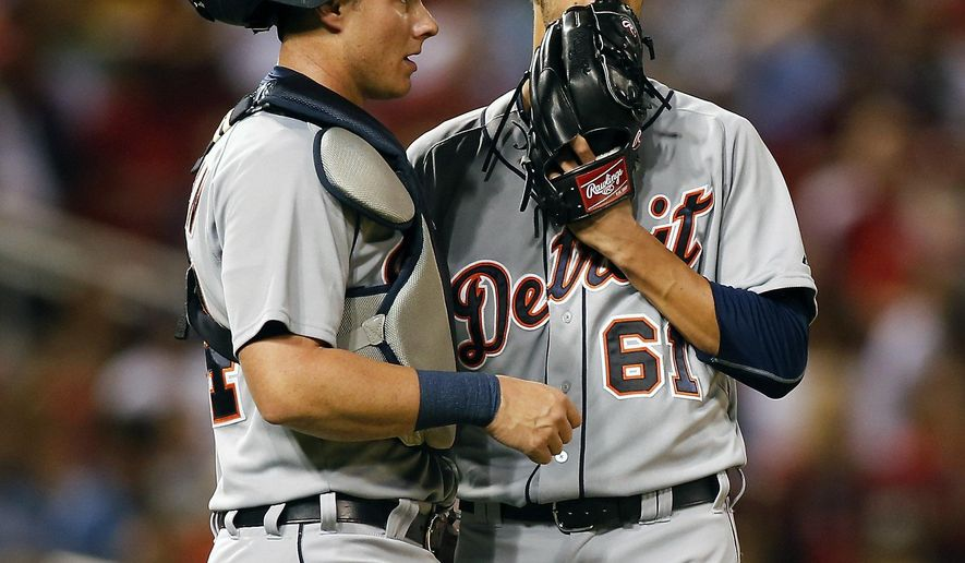 Detroit Tigers catcher James McCann, left, talks with starting pitcher Shane Greene during the fourth inning of a baseball game against the St. Louis Cardinals Friday, May 15, 2015, in St. Louis. (AP Photo/Scott Kane)