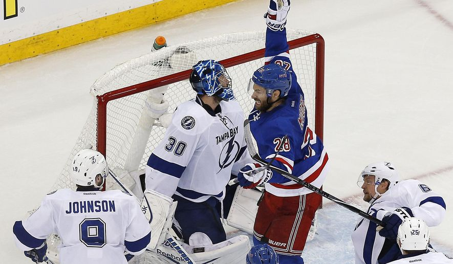 New York Rangers center Dominic Moore (28) celebrates after scoring against the Tampa Bay Lightning during the third period of Game 1 of the Eastern Conference final during the NHL hockey Stanley Cup playoffs, Saturday, May 16, 2015, in New York. The Rangers won 2-1. (AP Photo/Julie Jacobson)