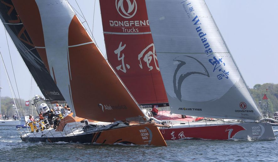 Team Alvimedica, left, and Team Dongfeng, right, racing yachts in the international Volvo Ocean Race, compete in Newport Harbor, Sunday, May 17, 2015, in Newport, R.I. The race departed Newport Sunday heading for Lisbon, Portugal, in the seventh leg of the global race. (AP Photo/Steven Senne)