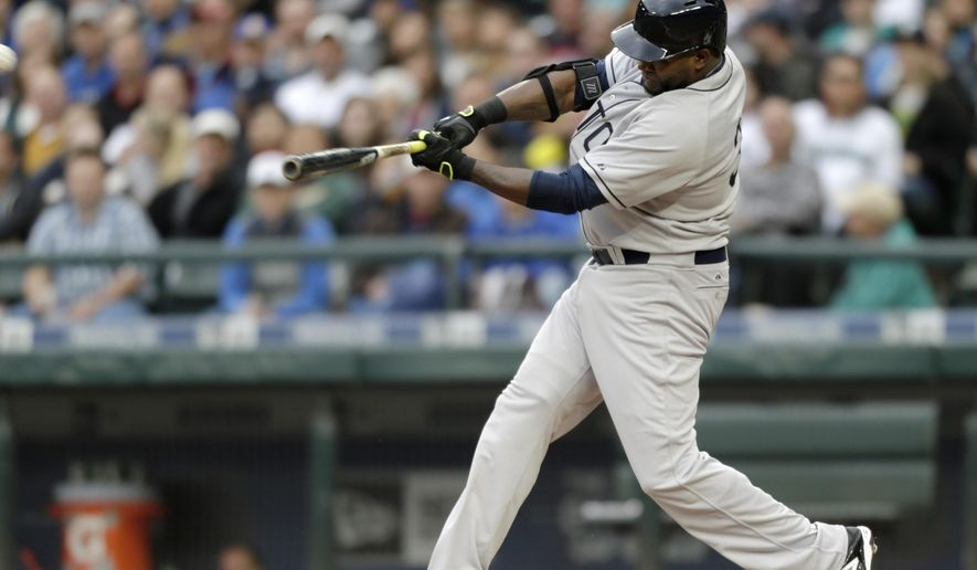 Boston Red Sox's David Ortiz hits a solo home run off Seattle Mariners' Felix Hernandez during the third inning of a baseball game Saturday, May 16, 2015, in Seattle. Both teams are wearing uniforms of Negro League teams of 1946, Seattle is the Seattle Steelheads and Boston that of the Boston Giants. (AP Photo/John Froschauer)