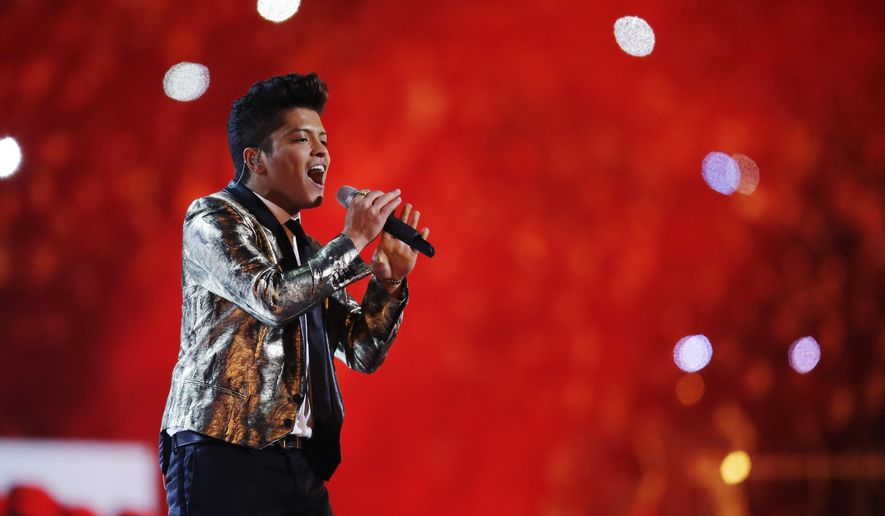 FILE - In this Feb. 2, 2014 file photo, Bruno Mars performs during the halftime show of the NFL Super Bowl XLVIII football game between the Seattle Seahawks and the Denver Broncos in East Rutherford, N.J. Mars headlines the second night of the Rock in Rio USA festival which runs May 15-16, 2015, in Las Vegas. Other performers include John Legend, Big Sean and MAGIC! (AP Photo/Julio Cortez, File)