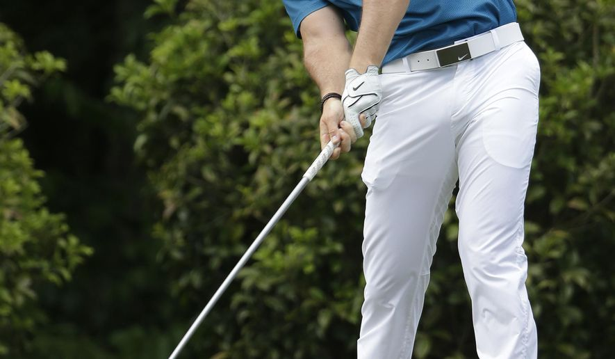Rory McIlroy, of Northern Ireland, hits his tee shot on the fifth hole during the final round of the Wells Fargo Championship golf tournament at Quail Hollow Club in Charlotte, N.C., Sunday, May 17, 2015. (AP Photo/Chuck Burton)
