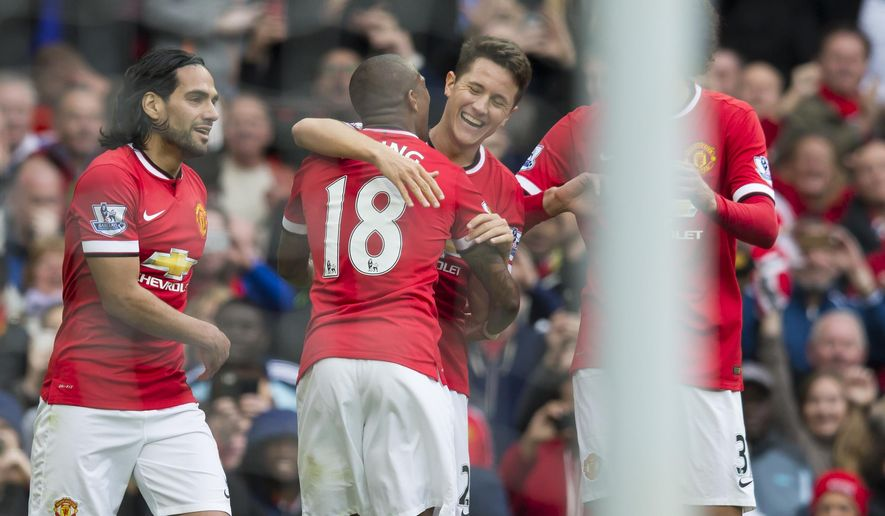 Manchester United's Abder Herrera, center right, celebrates with teammates after scoring during the English Premier League soccer match between Manchester United and Arsenal at Old Trafford Stadium, Manchester, England, Sunday, May 17, 2015. (AP Photo/Jon Super)