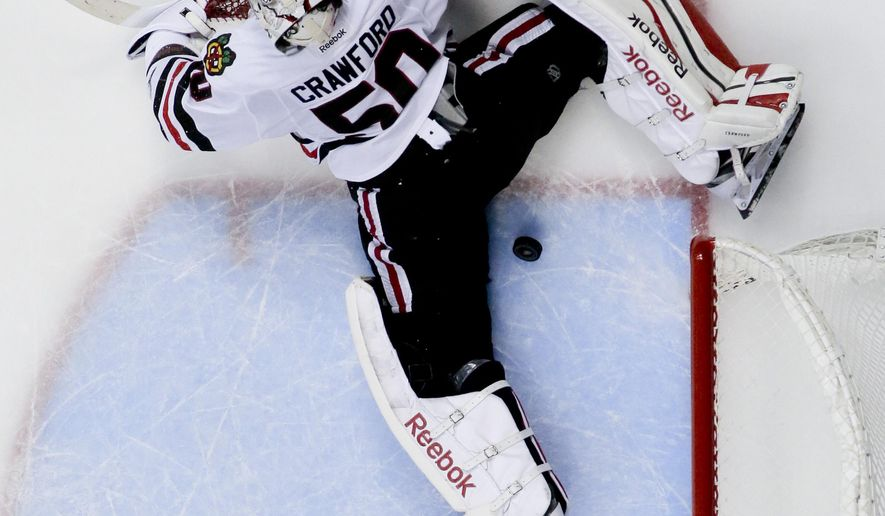 Chicago Blackhawks goalie Corey Crawford fails to stop a goal by Anaheim Ducks center Nate Thompson during the third period of Game 1 of the Western Conference final during the NHL hockey Stanley Cup playoffs in Anaheim, Calif., Sunday, May 17, 2015. (AP Photo/Chris Carlson)