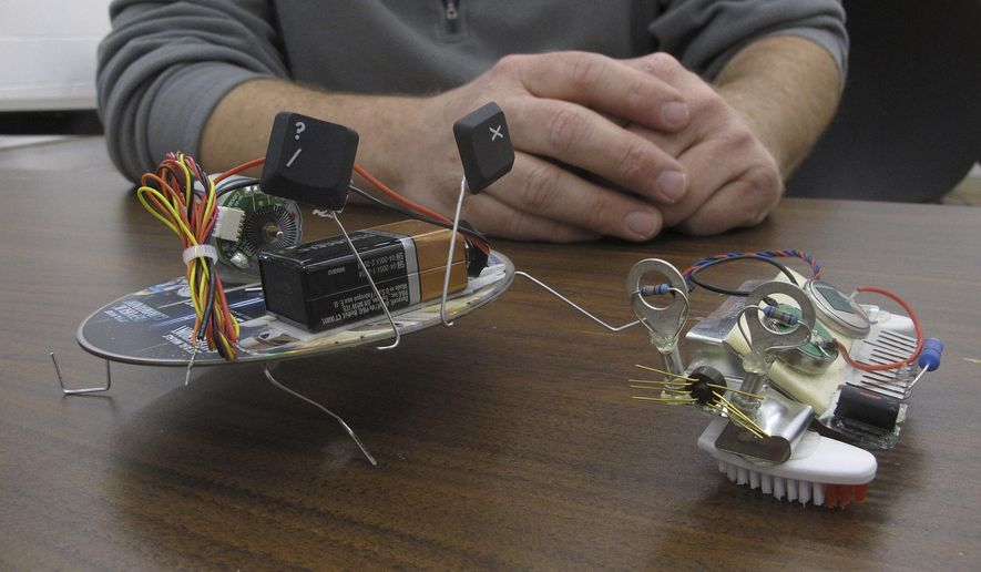 ** ADVANCE FOR SUNDAY MAY 17, 2015 AND THEREAFTER ** In this May 11, 2015 photo, two small robots made from a CD, toothbrush bristles and motors sit on a classroom table at the Reuseum, a technology education and recycling center in Boise, Idaho. Founder John Schiff says the Reuseum inspires kids to pursue science and technology related fields by providing opportunities to tinker with used materials. (AP Photo/Ryan Struyk)
