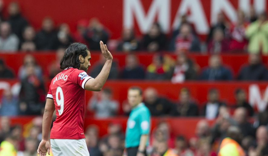 Manchester United's Radamel Falcao waves to supporters as he is substituted during the English Premier League soccer match between Manchester United and Arsenal at Old Trafford Stadium, Manchester, England, Sunday, May 17, 2015. (AP Photo/Jon Super)