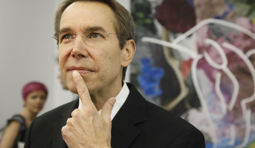 """FILE - In this April 23, 2010 file photo, artist Jeff Koons poses for photographers at the Pinchuk Art Center in Kiev, Ukraine. Jeff Koons has agreed to auction off his """"Coloring Book"""" sculpture at the amfAR gala during the 68th Cannes international film festival. (AP Photo/Efrem Lukatsky, File)"""