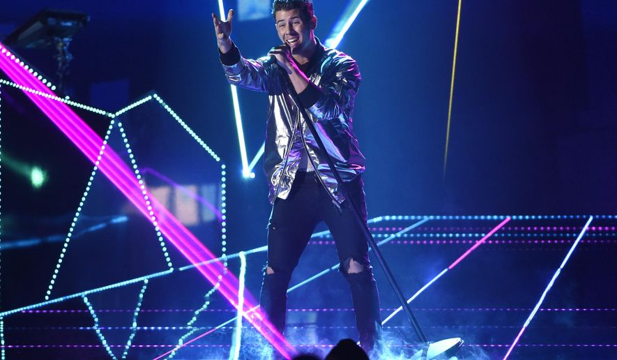 Nick Jonas performs at the Billboard Music Awards at the MGM Grand Garden Arena on Sunday, May 17, 2015, in Las Vegas. (Photo by Chris Pizzello/Invision/AP)
