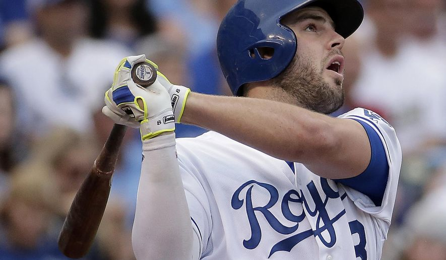 Kansas City Royals' Mike Moustakas watches a sacrifice fly  that scored Omar Infante during the third inning of a baseball game against the New York Yankees on Saturday, May 16, 2015, in Kansas City, Mo. (AP Photo/Charlie Riedel)