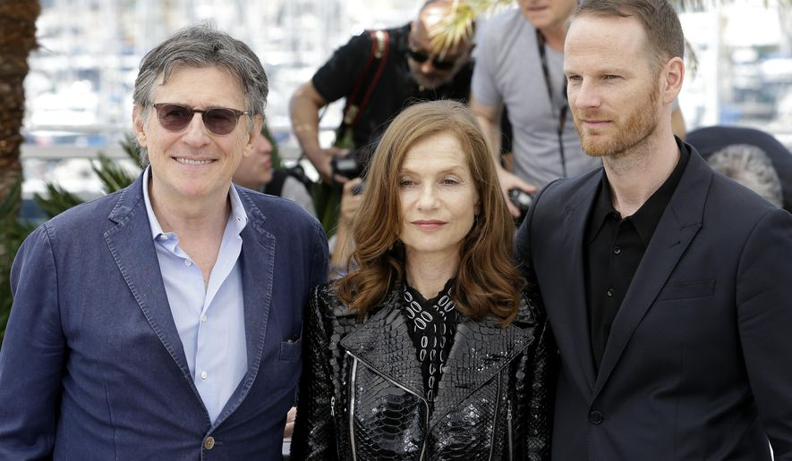 From left, actors Gabriel Byrne, Isabelle Huppert, and director Joachim Trier pose for photographers during a photo call for the film Louder than Bombs, at the 68th international film festival, Cannes, southern France, Monday, May 18, 2015. (AP Photo/Lionel Cironneau)