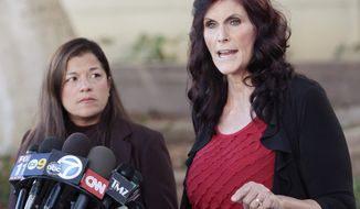 "FILE - In this Thursday, Sept. 20, 2012, file photo, Cindy Lee Garcia, one of the actresses in ""Innocence of Muslims,"" and attorney M. Cris Armenta hold a news conference in Los Angeles asking a judge to issue an injunction demanding a 14-minute trailer for the film be pulled from YouTube. A federal appeals court on Monday, May 18, 2015 overturned an order for YouTube to take down the anti-Muslim film that sparked violence in the Middle East and death threats to actors. (AP Photo/Jason Redmond, File)"