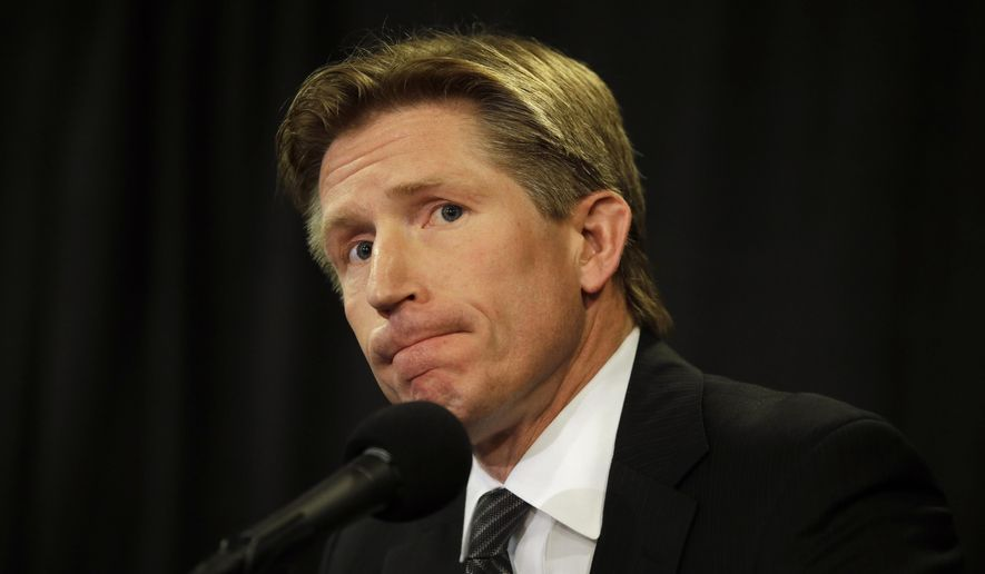 Philadelphia Flyers newly-hired head coach Dave Hakstol listens to a reporter's question during a news conference, Monday, May 18, 2015, in Philadelphia. (AP Photo/Matt Slocum)