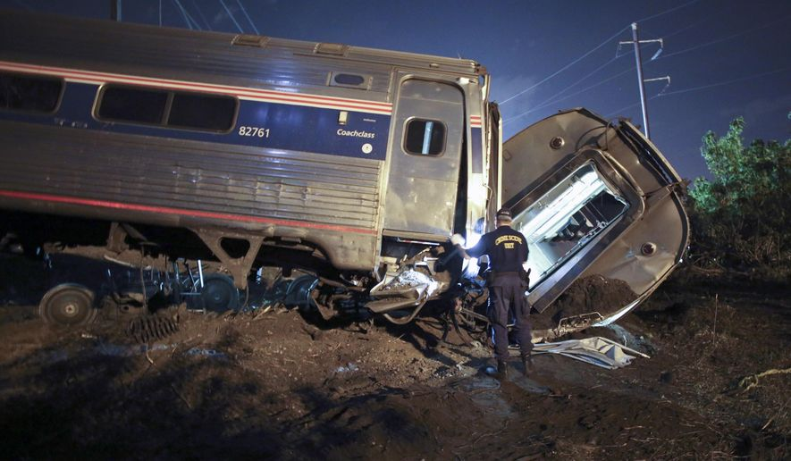 Emergency personnel work the scene of a deadly train wreck in Philadelphia in this May 12, 2015, file photo. (AP Photo/ Joseph Kaczmarek, File)