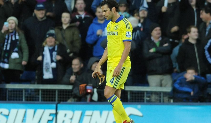 Chelsea's Cesc Fabregas leaves the pitch after being sent off by referee Mike Jones during the English Premier League soccer match between West Bromwich Albion and Chelsea at the Hawthorns, West Bromwich, England, Monday, May 18, 2015. (AP Photo/Rui Vieira)
