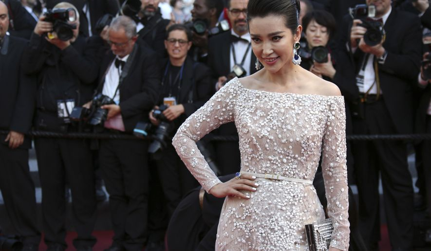 In this photo taken Sunday, May 17, 2015, actress Li Bingbing poses for photographers as she arrives for the screening of the film Carol at the 68th international film festival, Cannes, southern France. (Photo by Joel Ryan/Invision/AP)