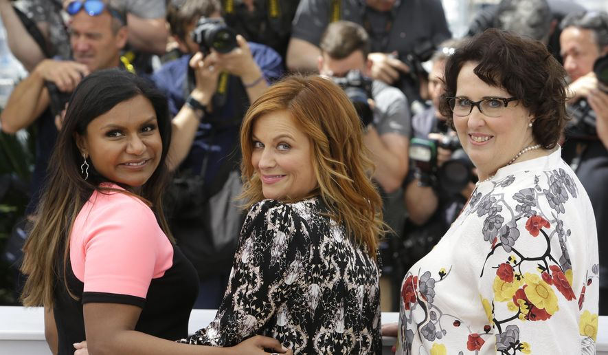 From left, Mindy Kaling, Amy Poehler and Phyllis Smith pose for photographers during a photo call for the film Inside Out, at the 68th international film festival, Cannes, southern France, Monday, May 18, 2015. (AP Photo/Lionel Cironneau)