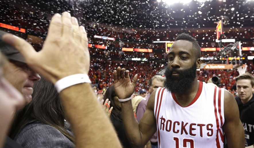 Houston Rockets' James Harden (13) celebrates after defeating the Los Angeles Clippers 113-100 in Game 7 of the NBA basketball Western Conference semifinals, Sunday, May 17, 2015, in Houston. (AP Photo/David J. Phillip)