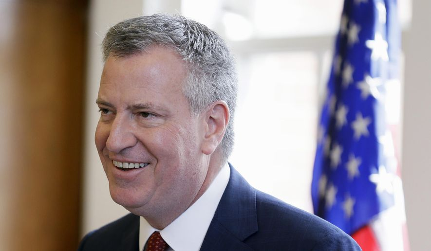 In this April 16, 2015, file photo, New York City Mayor Bill de Blasio speaks about income inequality during a visit to Drake University, Thursday, April 16, 2015, in Des Moines, Iowa. De Balsio's unofficial cabinet includes about a half-dozen outside political strategists, many of whom he has known for decades. (AP Photo/Charlie Neibergall, File)