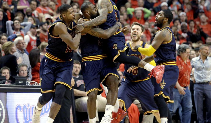 FILE - In this May 10, 2015, file photo, Cleveland Cavaliers' LeBron James, second from left, hugs teammate J.R. Smith, as they celebrate beating the Chicago Bulls in Game 4 of the conference semifinals in the NBA playoffs in Chicago. From left are Tristan Thompson, James, Smith, Matthew Dellavedova, and Kyrie Irving, right.  J.R. Smith, the enigmatic shooting guard, who came to the Cavaliers with the reputation of being diffcult, has found a new home in Cleveland and he's relishing the chance to be part of a team moving toward an NBA title. (AP Photo/Nam Y. Huh, File)