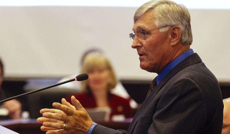 Director of Health and Welfare Dick Armstrong testifies before a joint session of the Senate Judiciary and Rules and the House Judiciary, Rules, and Administration committees during a special session of the Idaho legislature at the state Capitol building on Monday, May 18, 2015 in Boise, Idaho. (AP Photo/Otto Kitsinger)