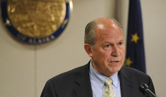 Alaska Gov. Bill Walker holds a news conference in Anchorage concerning his action on the budget on May 18, 2015. (Bill Roth/Alaska Dispatch News via Associated Press) **FILE**