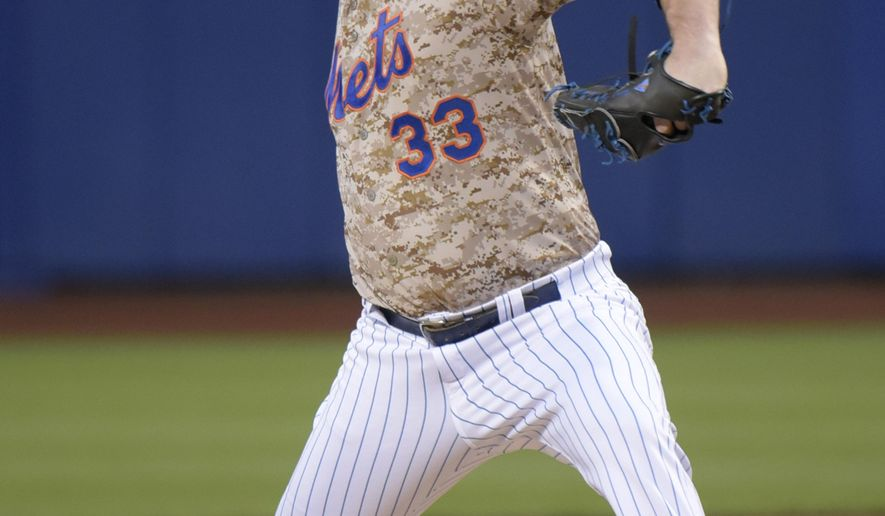 New York Mets pitcher Matt Harvey delivers the ball to the St. Louis Cardinals during the first inning of a baseball game Monday, May 18, 2015, at Citi Field in New York. (AP Photo/Bill Kostroun)