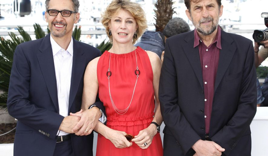 John Turturro, Margherita Buy and director Nanni Moretti pose for photographers during a photo call for the film Mia Madre (My Mother), at the 68th international film festival, Cannes, southern France, Saturday, May 16, 2015. (AP Photo/Lionel Cironneau)