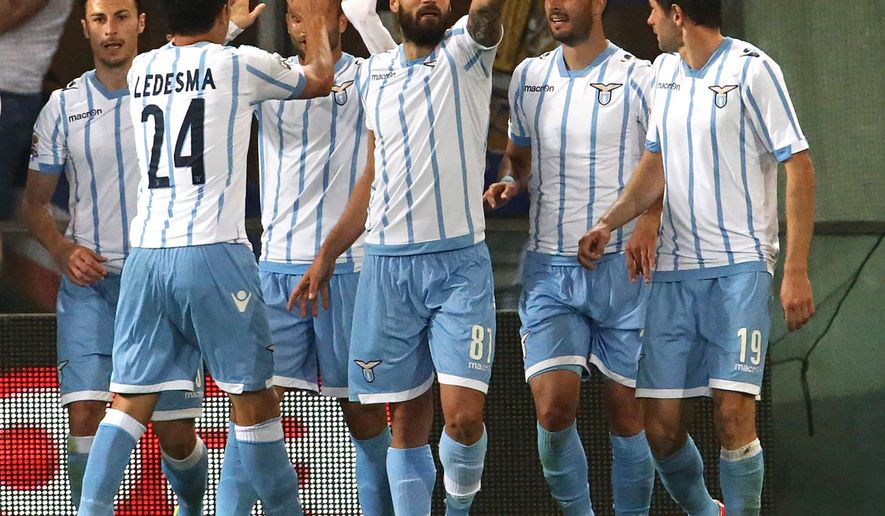 Lazio players celebrate a goal during a Serie A soccer match between Sampdoria and  Lazio, in Genoa, Italy, Saturday, May 16, 2015. (AP Photo/Carlo Baroncini)