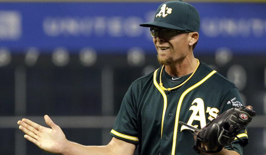 Oakland Athletics relief pitcher Tyler Clippard reacts after striking out Houston Astros' Jason Castro in the ninth inning to end a baseball game Monday, May 18, 2018, in Houston. The Athletics won 2-1. (AP Photo/David J. Phillip)