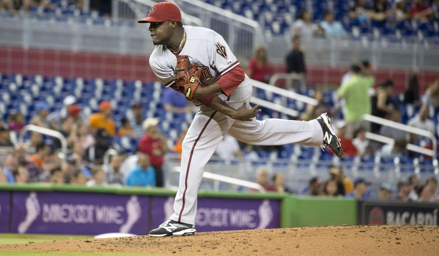 Arizona Diamondbacks starting pitcher Rubby De La Rosa throws to the Miami Marlins during the first inning of a baseball game in Miami, Monday, May 18, 2015.  (AP Photo/J Pat Carter)