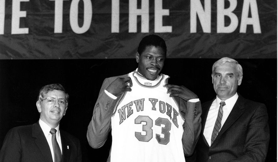 FILE - In this June 18, 1985, file photo, Patrick Ewing accepts his New York Knicks jersey from Dave DeBusschere, right, general manager of the Knicks, as NBA commissioner David Stern look on, at the NBA Draft in New York. The NBA draft lottery debuted 30 years ago. The 2015 NBA draft lottery will take place in New York on Tuesday, May 19, 2015. (AP Photo/Marty Lederhandler, File)
