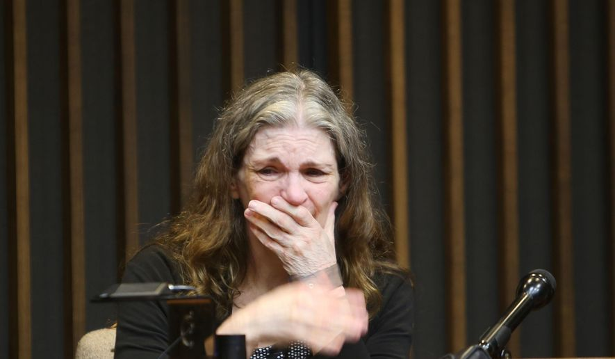 Donna Scrivo, the St. Clair Shores mother on trial in Macomb County for killing and dismembering her adult son, Ramsey Scrivo in January 2014 in his St. Clair Shores condo, takes the stand before Judge Richard Caretti at the Macomb County Circuit Court in Mount Clemens, Mich., Monday, May 18, 2015. (Regina H. Boone/Detroit Free Press via AP)