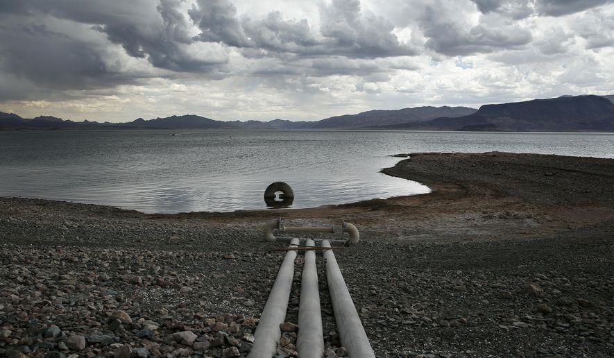 Water intake pipes that were once underwater sit above the water line along Lake Mead in the Lake Mead National Recreation Area, Monday, May 18, 2015, near Boulder City, Nev. Federal water managers are projecting Lake Mead will drop to levels in January 2017 that could force supply cuts to Arizona and Nevada. (AP Photo/John Locher)