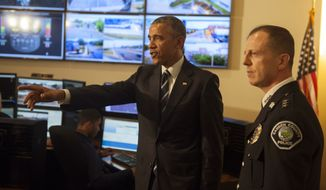 President Obama tours the Real-Time Tactical Operational Intelligence Center in the Camden County (N.J.) Police Administration Building on Monday with Camden County Police Chief J. Scott Thomson. (Associated Press)
