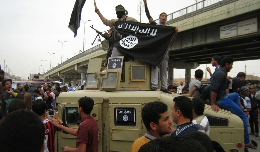 Al Qaeda fighters wave flags as they patrol the streets in a commandeered Iraqi military vehicle in Fallujah, Iraq, March 20, 2014. (Associated Press) ** FILE **