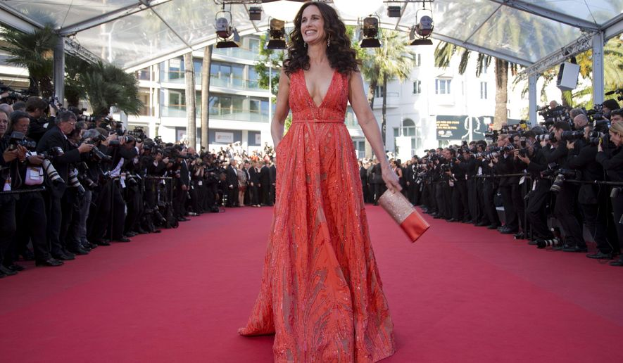 Actress Andie MacDowell poses for photographers as she arrives for the screening of the film Inside Out at the 68th international film festival, Cannes, southern France, Monday, May 18, 2015. (AP Photo/Thibault Camus)