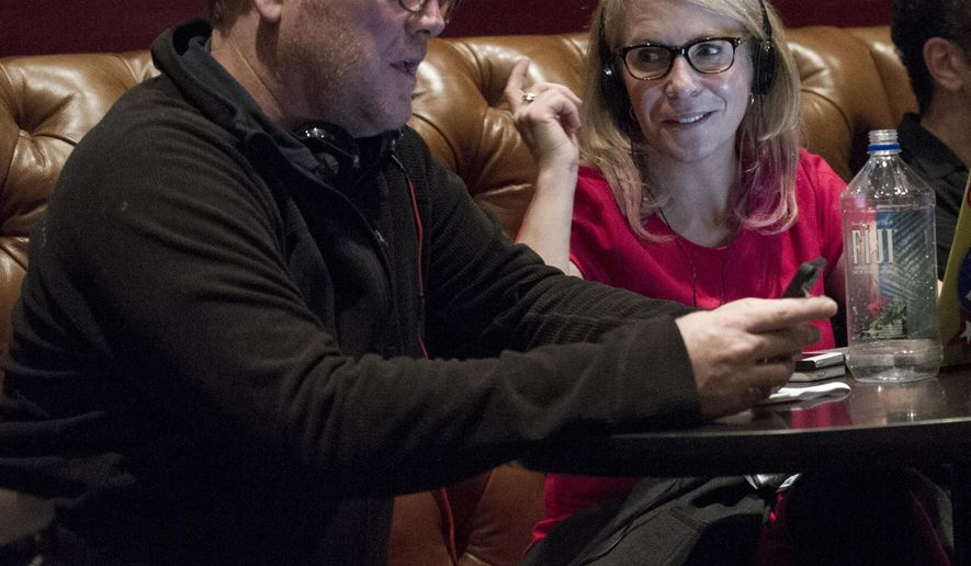 "This image released by Bravo shows executive producer Robert Duncan McNeill, left, and Marti Noxon writer-producer of ""The Girlfriends Guide to Divorce."" Showrunners, formally known as executive producers, generally arise from the ranks of writers. Although women are underrepresented  as TV writers _ holding less than a third of cable and broadcast jobs, according to the latest Writers Guild of America study _ the ones who rise to the top can pull other women along. (Carole Segal/Bravo via AP)"
