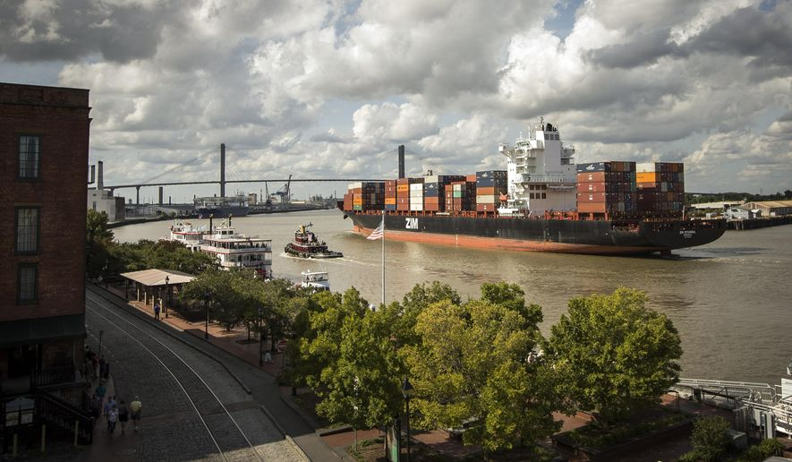 FILE - In this Oct. 7, 2014 file photo, The container ship Zim Istanbul makes it's way up the Savannah River past historic River Street in Savannah, Ga. The top executive over Georgia's seaports in Savannah and Brunswick said Monday he expects another record-breaking fiscal year following a busy spring in which East Coast ports benefited from a labor dispute on the West Coast. (AP Photo/Stephen B. Morton, File)