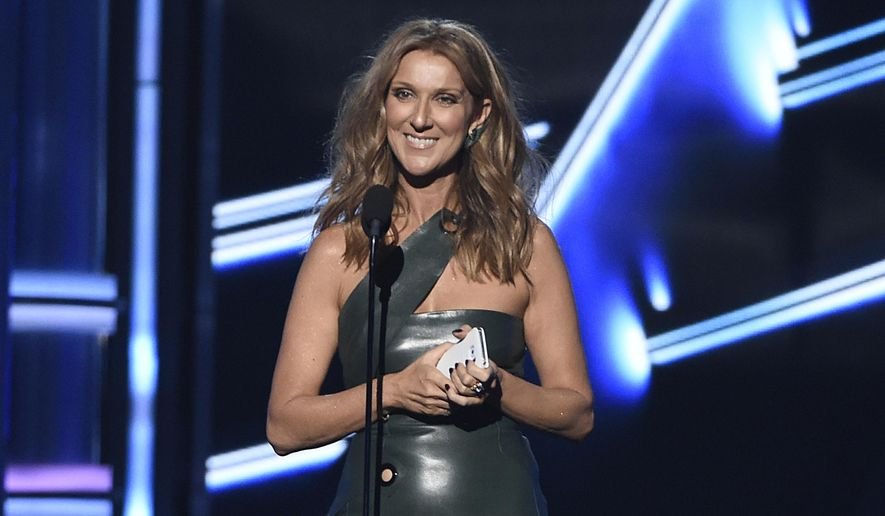 Celine Dion presents the award for top male artist at the Billboard Music Awards at the MGM Grand Garden Arena on Sunday, May 17, 2015, in Las Vegas. (Photo by Chris Pizzello/Invision/AP)